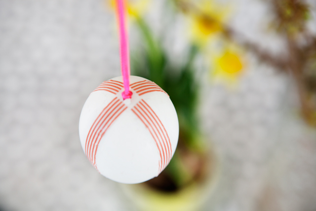 Blown out Easter Eggs decorated with colorful masking tape